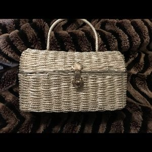 Women's silver holiday woven hand bag.
